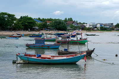 Thai fishing village with several boats in the water
