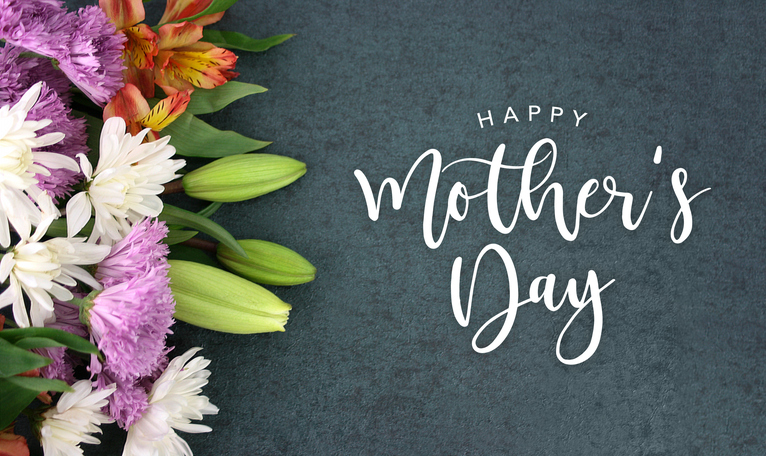 "A photo of flowers with the text ""Happy Mother's Day!\"""
