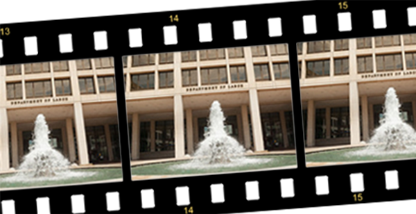 A strip of film bearing the image of the Frances Perkins Building's exterior.