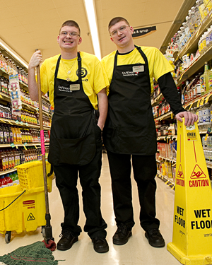 "Identical twins Edwin and Jeffrey Willie, who have intellectual disabilities, work at a grocery store in Maryland. They're just one of many examples of ""integrated"" employment, where people with disabilities work alongside those without."