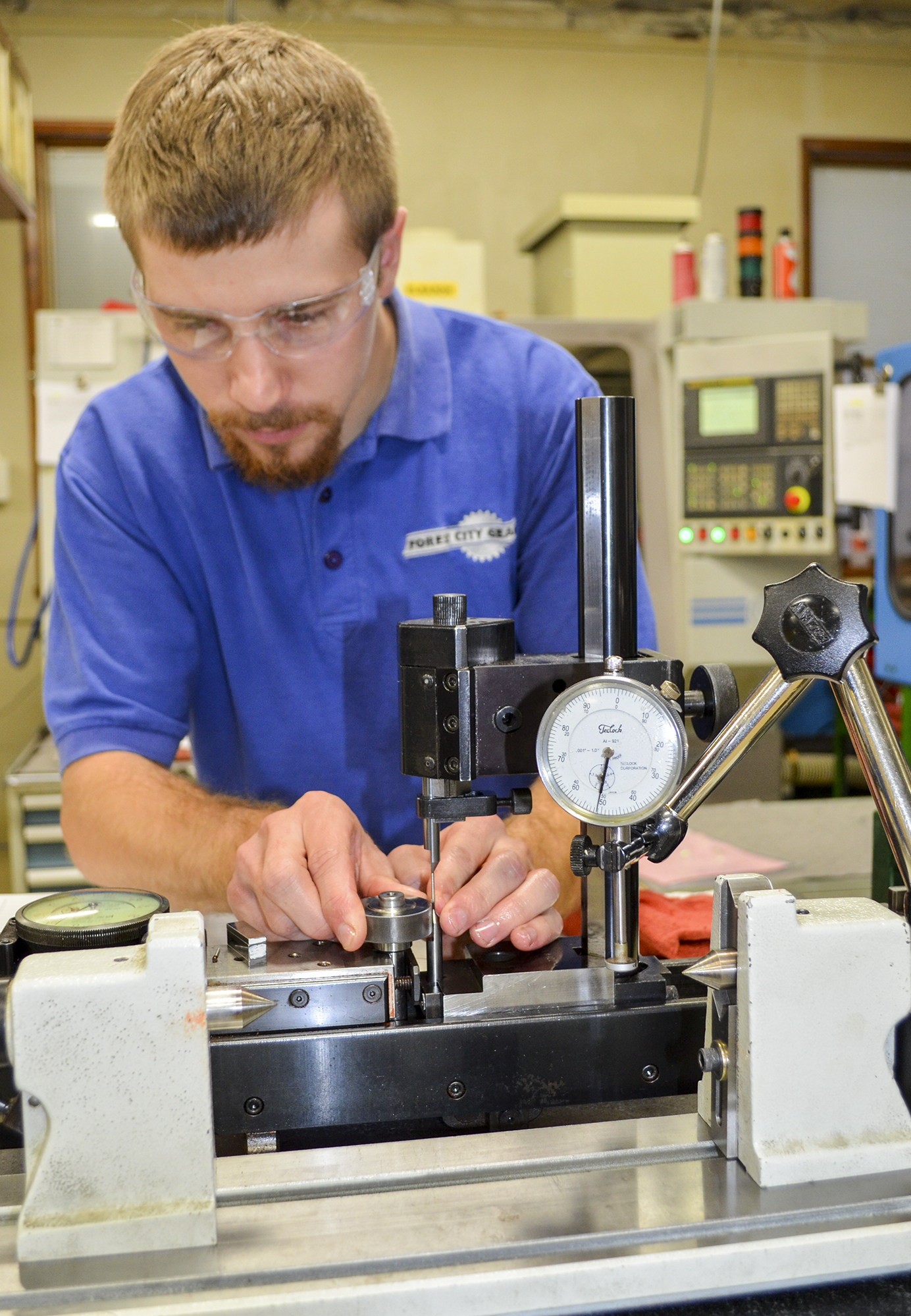 Cody Insko works on manufacturing a gear using a CNC hobby mill.