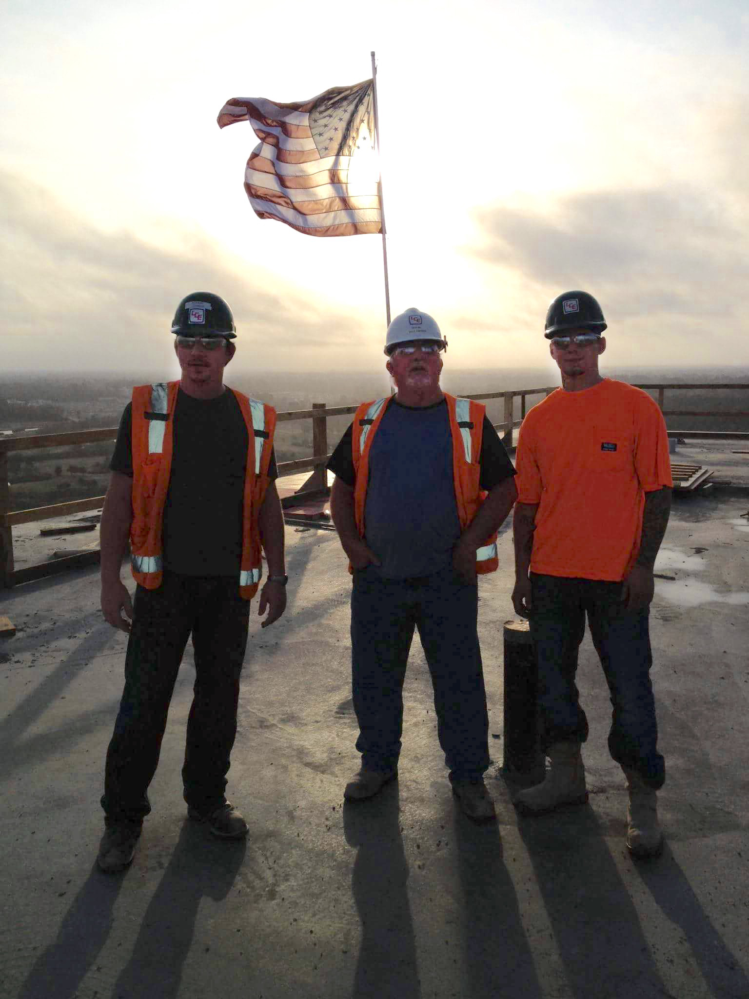 Timothy Loy, far right, stands on the roof of the Golden Nugget Casino in Lake Charles, Louisiana. Next to him are father and son Richard and Dale Johnson, both of whom are electrical journeyman.