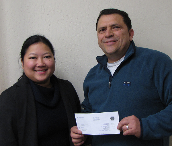 Jesus Mondragon with Wage and Hour Division Investigator Mary Pham.