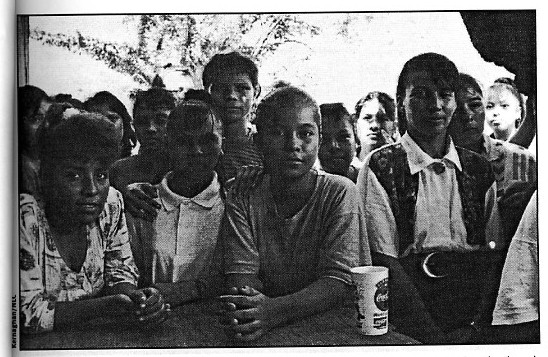 Fifteen-year-old Wendy Diaz (center) and other young workers at a Honduran factory where Kathie Lee brand pants were made. Credit: Institute for Global Labour and Human Rights