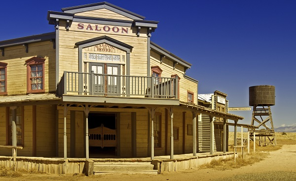 stock image of a saloon in an Old West town