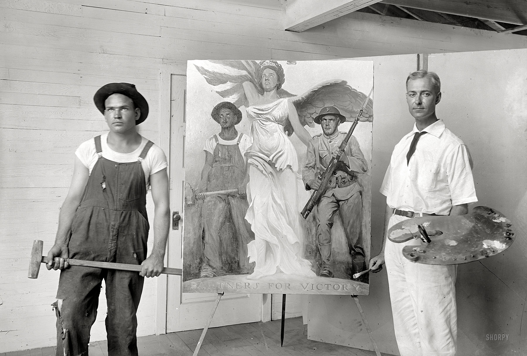 Patriotic art was commissioned to inspire workers to join wartime efforts, including this like this awesome painting by Gerrit A. Beneker – pictured here with his model.