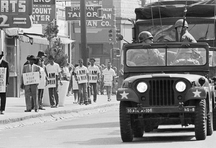 Tennessee National Guard troops escort a protest march by striking Memphis sanitation workers on March 30, 1968.