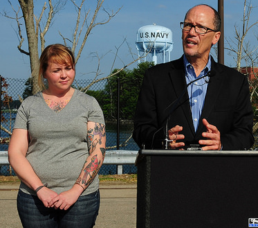 Jen, a modern Rosie the Riveter, stands next to Secretary Perez at the Portsmouth Navy Yard