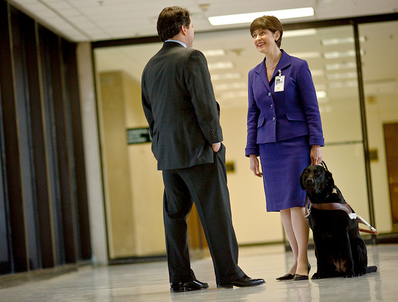Kathy Peery, a legislative affairs specialist for a federal agency, and her service dog.