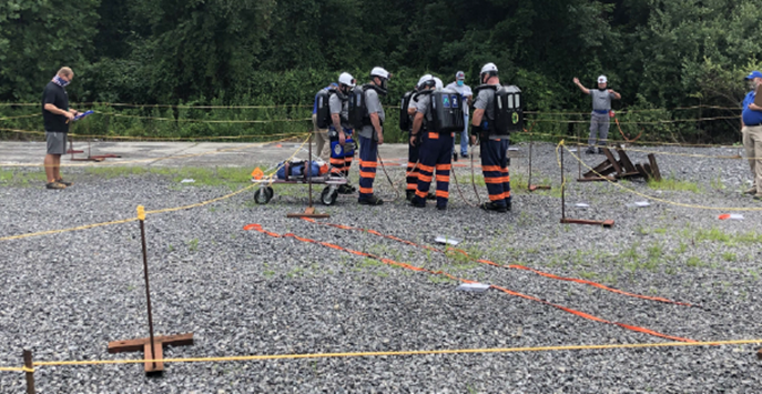 Judges from the U.S. Department of Labor Mine Safety and Health Administration and the Virginia Department of Mines, Minerals and Energy evaluate a rescue team during the nation's first successful mine rescue contest of 2020 in Norton, Virginia.
