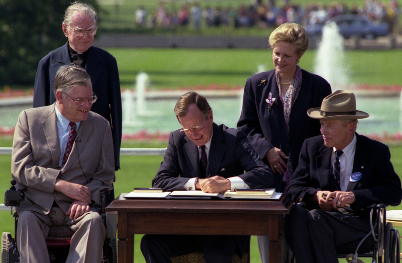 President George H.W. Bush signs the ADA in 1990.