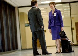 Kathy Peery, a legislative affairs specialist for a federal agency, and her service dog