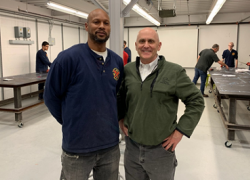 Caption: Assistant Secretary for Veterans' Employment and Training John Lowry visited the Plumbers and Gasfitters Local 5 Apprenticeship School in February 2020, where he met apprentices like Air Force veteran Edward Stallworth who receive a paycheck while also getting training for high-skill, in-demand civilian careers.