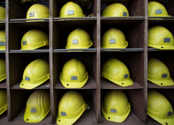 shelving with rows of yellow hard hats