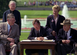 President George H.W. Bush signs the Americans with Disabilities Act on July 26, 1990.