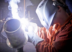 Alt text: Graphic shows a veteran welding. National Hire a Veteran Day. July 25, 2020.