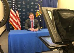 Secretary Walsh films a live interview.