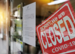 Photo: A storefront has a closed sign.
